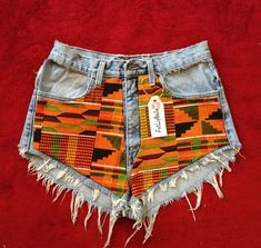 Vintage high waist or low rise kente shorts by FatLipBella on Etsy from FatLipBella on Etsy. Saved to fatlipbella. African Print Skirt, African Print Dresses, African Print Fashion, Africa Fashion, African Wear, African Attire, African Fabric, African Women, African Dress