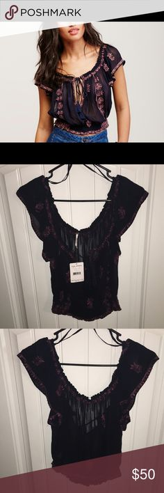 Free People Paisley Park Blouse I bought it for a summer outfit & never got around to wearing it. Very sexy top. I would wear it to the beach or on vacation. Colors are black & deep purple (looks Mauve in person) stitch detail. Free People Tops Blouses