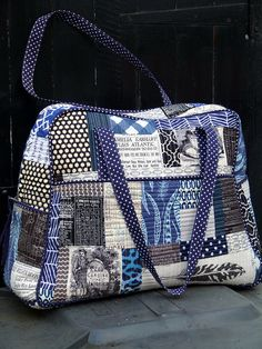 Quilted Weekender Bag by Laura @ Needles, Pins and Baking Tins, via Flickr