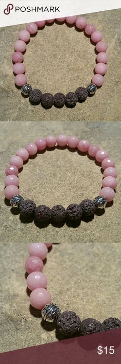 """Dark Gray Lava & Pink Chalcedony Stone Bracelet New, beautifully handcrafted in Florida, genuine 8mm volcanic basalt lava & pink chalcedony stone mala bracelet with silver tone Tibetian metal spacer beads. Perfect for chakra, spiritual, health meditation work, as an essential oil diffuser, just enjoying it's beauty alone, or layering with my other boho stackers. Thick high quality stretch cord, inside circumference 6.75"""" Smaller size also in my botique. Thank you for visiting my closet…"""