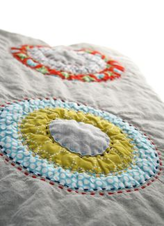 circles quilt by namoo.  Lots of hand stitching and sashiko sort of quilting