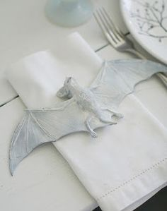 """LESS doing it """"right"""" = more whimsey (bats spray painted for the table)"""