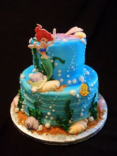Edible images of Arial and Flounder. Butter cream cake. Chocolate shells.