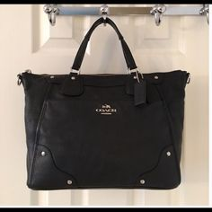 Coach tote Great condition coach tote. Silver hardware. Zip closure . 3 interior pockets. Double hang tag. Magnetic front pocket. Measures 12x5.25x10x4.75. Beautiful leather! Please ask if you have questions. (F34040) Coach Bags Totes
