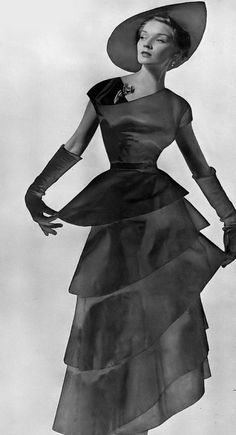 1949 Model in swirling tiered dress by Jo Copeland of Patullo for Neiman Marcus 40s Fashion, Classic Fashion, Vintage Fashion, 1940s Vintage Dresses, Tiered Dress, Formal Wear, Timeline, Neiman Marcus, High Neck Dress