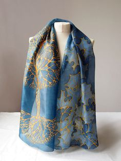 Silk scarf Gold Tree is a handpainted scarves decorated with yellow tree on a navy blue background. Gold Tree scarf was designed by me as a symbol of happiness, as a token of good fortune. Inspiration for silhouette of the tree was a Celtic Tree of Life. On the other end of the scarf you can