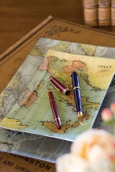 Mod podge maps underneath to clear glass dishes...to hold earring, pens etc.