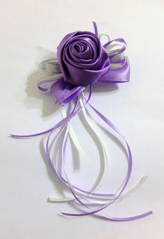Check this lilac satin rose corsage out. Handmade with pearl, lace and satin rose. Pick it for a purple wedding.