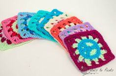 PEACE SIGN granny squares.  Saw with outer maroon color done in blue, green, yellow varigated yarn, looked like TIE DYE!