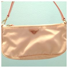✨HP✨NWOT Prada Nylon Shoulder Pochette Authentic Prada Pochette in tessuto/saffiano nylon material & color is Alabastro. This was purchased directly from Neiman Marcus & never been used. It is clean inside and out as seen in pictures. It comes with dust bag and authenticity cards. Sold out online. Accepting offers via offer button! Prada Bags