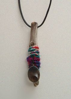 Driftwood Sari Silk Yarn and a Charm necklace. $16.00, via Etsy.