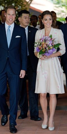 SEPTEMBER 11, 2012 Duchess Catherine toured Singapore's National Botanical Gardens in a bespoke pale pink dress by Jenny Packham with hand-painted floral details by De Gourmay. She finished the look with a loose half-up 'do.
