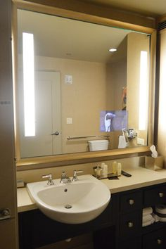 I kind of want to frame the giant bathroom mirror.  Probably in something other than gold/brass.