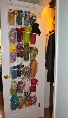 My client LOVES scarves so we used a hanging shoe bag to store them on the inside of her closet door. Simple & pretty!