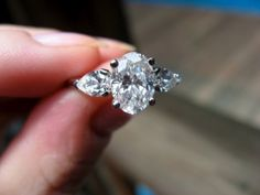 1.5 ct oval center with pear side stones. Perfect!!!!!! Could do a halo around it all ;)