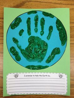 Earth Day Art to set a goal to help the Earth and write down how you plan to do it. I love the visual aid to remind everyone to be mindful about the imprint that they leave on the Earth. <3