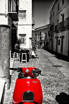 Red ~ Street scene in Arcos de la Frontera, Andalusia, Spain © Stephen Candler Photography