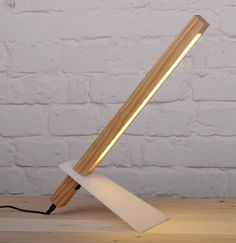 Our Handcrafted Wooden desk lamp looks more like a sculpture than a light fixture with its super thin and modern lamp design. Plus it's sliding acrylic leg for adjusting the desk lamp height. The desk lamp has 18 LEDs to make it both energy efficient and Wooden Desk Lamp, Wood Desk, Luminaria Diy, Lampe Decoration, Desk Light, Unique Lamps, Lighting Design, Lighting Ideas, Light Fixtures