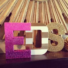 I bought some box letters of my initials a few months ago, haven't done anything with them. I really like that middle striped one!