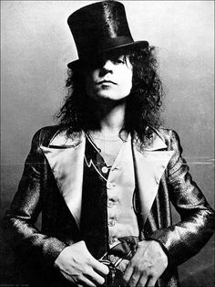 Marc Bolan...top hat & satin