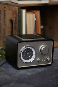 Crosley Solo Radio Speaker | Free People Vintage-inspired American made radio featuring an AM/FM receiver featuring an aviator-style dial along with a plug, ready to fit another audio device.