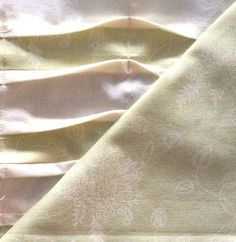 Close up Block type: 4-patch Block size: 10 1/2 inches Colour scheme: reds, greens and neutrals Texture/fabric manipulation: pin tucks in two colours Cut: 2 floral 5 1/2 in squares 3 pale green 1 1…
