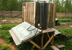 Simple solar shower with holding tank -- could be built for $0!!!!