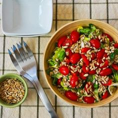 Canned Tuna and Tomato Salad with Sunflower Seeds; please don't turn your nose up at the idea of canned tuna because this is seriously good, especially if you use the Italian tuna packed in olive oil.  [from KalynsKitchen.com]  #DeliciouslyHealthyLowCarb