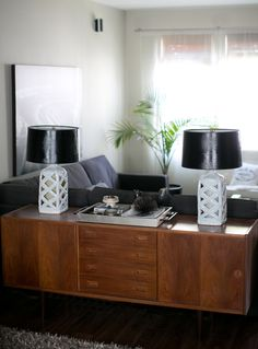 Black and white lamps on a teak buffet