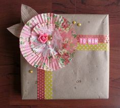 Printed cupcake liners crafted into flowers with Washi Tape accent (Precocious Paper: March 2013)