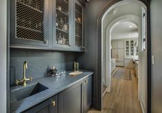 """Plato Custom Cabinetry in """"Moody Blue"""" paint with antique brass mesh door inserts make the most handsome wet-bar. Different Color Kitchen Cabinets, Kitchen Cabinet Colors, Kitchen Colors, Kitchen Design, Wet Bar Cabinets, Navy Cabinets, Wet Bars, Custom Cabinetry, Other Rooms"""