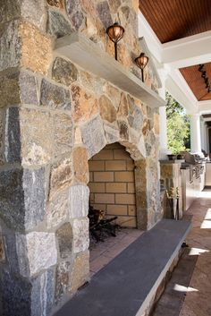 The fireplace and chimney were also faced with the Boston Blend Mosaic thin stone veneer. Via Modern New England Home & Houzz