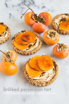 These persimmon tarts are a fun autumn dessert. It's full of texture and different flavors to keep your palate entertained. The crust is crunchy and delightful, the maple cinnamon cream cheese is warm and comforting, and the brûléed persimmon slices give the slightest hint of bitterness and a whole lot of sophistication.
