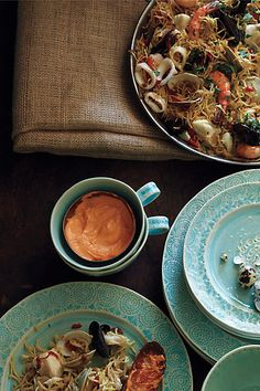 Old Havana dinnerware from Anthropologie. Love everything about this, the shape of the cups, the pointelle circles, the aqua glaze.