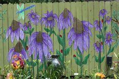 Benvenuti Garden, An AHS Display Garden in Cypress Texas. Friend, Karen, is busy painting a beautiful mural on their fence.
