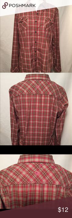 North Face Women's Plaid Shirt, Size XL Rust plaid women's shirt. Size XL. Polyester and cotton. Good condition. Floral yoke detail. The North Face Tops Blouses