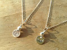 Loved Ones Personalised Charm Necklace. This delicate charm necklace is hand stamped with 2 initials. It is very small and is a classic and simple style so can be worn daily. This would be an ideal present for a special someone in your life. www.lydiadesigns.co.uk