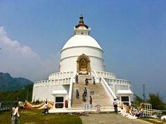 Visit the World Peace Pagoda at Pokhara, Nepal. This is such a spiritual place, a place where the world comes together; something we need more of these days.