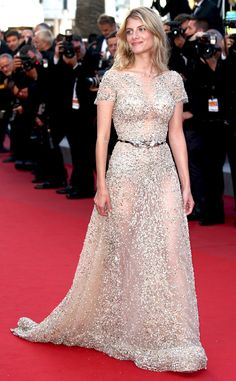 2015 Cannes: Melanie Laurent is wearing a short sleeve sheer & beaded Zuhair Murad gown with a belt. This gown is from the same collection as Katy Perry's Zuhair Murad dress from the Grammys. Melanie is radiant and gorgeous!