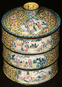 """Qing Dynasty wireless cloisonne stacking food container.  It comes apart into sections, including a lid.  It features hand-painted enamel scenery and flowers and copper trim. This item measures about 5 5/8"""" tall and the diameter measures about 4 1/8""""."""