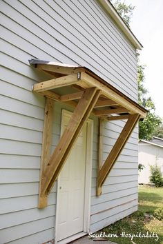 "Hello new architectural detail for the back door.  Now the house won't look so ""flat"" in back!"