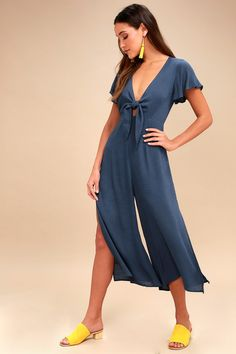 The Please and Thanks Teal Blue Tie-Front Culotte Jumpsuit is serving up stylish looks with an extra scoop of chic appeal! A tie-front bodice, with keyhole detail, and fluttering short sleeves top off this casual-cool jumpsuit composed of breezy woven fabric. Cropped wide-legs with side slits balance out the look. Hidden side zipper/clasp.