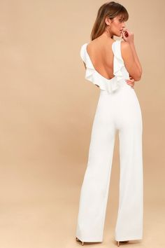 Be event ready in an instant with the Enamored White Backless Jumpsuit! Medium-weight knit shapes a rounded neckline and darted, sleeveless bodice. Fitted waist and relaxed, wide-leg pants. Open back, with chic ruffle detail, and hidden side zipper. Strapless Jumpsuit, Black Halter Jumpsuit, White Jumpsuit Formal, Rehearsal Dinner Outfits, Rompers Dressy, Wedding Jumpsuit, Quoi Porter, Jumpsuits For Women, Wide Leg Pants