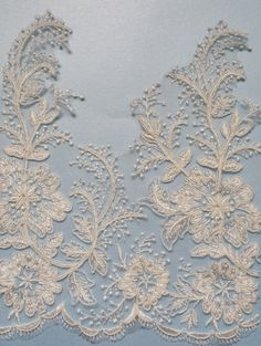 Montana is a 10 inch wide corded lace trim. It has a scalloped bottom edge and a shaped edge with motifs that are reminiscent of gypsophila. Available in ivory only and price per half yard.  Alice is manufactured in 5 yard rolls and sold in half yard multiples.   Shipping prices are for uninsured airmail. We can ship by courier - please ask for a quote  Multiple yards will be cut as a single piece. This lace can also be purchased by the roll (14 yards)