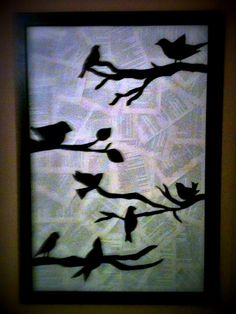 Bird silhouette art work made from black paper and book pages.