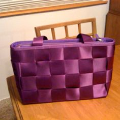 Purple seatbelt purse