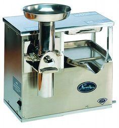 Norwalk Juicer, Model 275.  I use this machine everyday.... I produces the most amazing juice in the world....