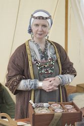 Photograph of Seiglynda Thyrisdotter of Elphinstone.  She appears to be wearing a white coif, with a blue wrap or sprang cap over that, and a diadem over all.
