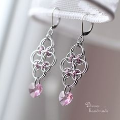 Earrings made of anodized aluminium rings of silver and light pink color and light pink swarovski hearts. Stainless steel mechanical closing hooks. Lenght inc. hook is 6.5 cm