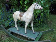 Antique White Rocking Horse  The calm rocking motion of the hobby horse is the favorite past time of children!